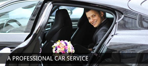 man smiling and holding flowers in a london taxi